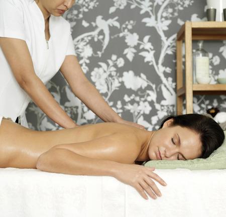 Woman enjoying a relaxing body massage photo