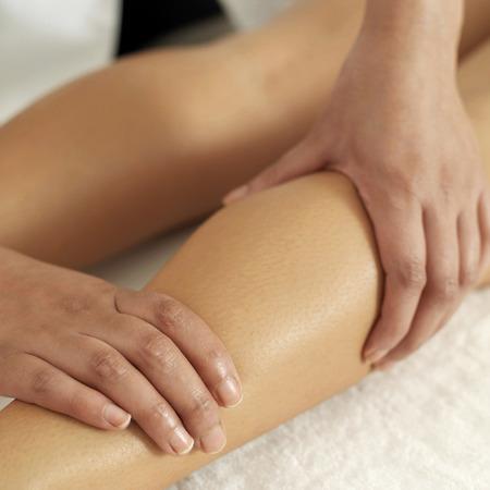 Woman enjoying a leg massage photo