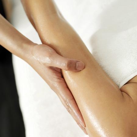 Woman enjoying a hand massage photo