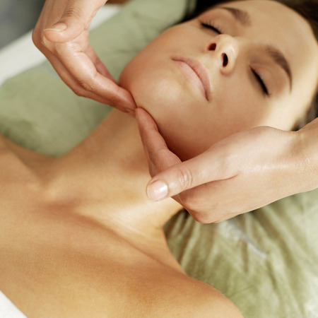 Woman enjoying a relaxing body massage Stock Photo - 26265026