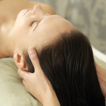Woman enjoying a head massage photo