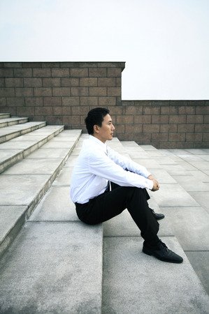 Businessman sitting at the staircase photo