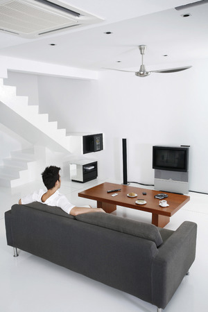 Guy in a spacious living room