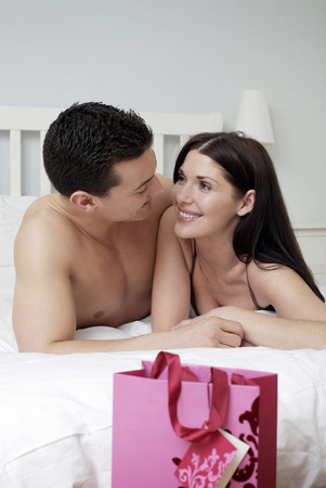 Couple lying forward on the bed photo