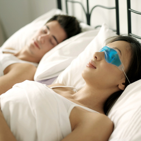 Couple sleeping comfortably on the bed photo