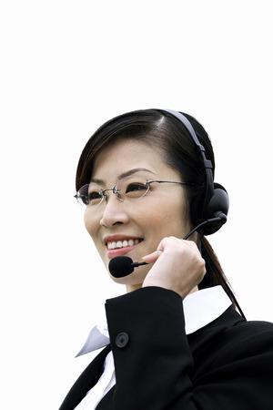 Businesswoman talking on the telephone headset photo