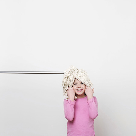 self discovery: A girl (5-7) with a mop on her head