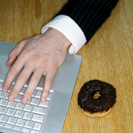 Doughnut and laptop photo