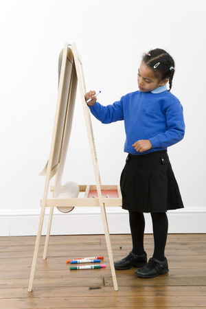 Girl drawing on drawing board photo