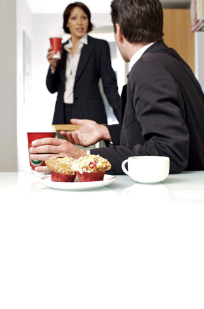 Couple having breakfast before going to work photo