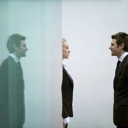 Business people looking at each other photo