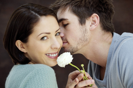 taking a wife: Man giving his girlfriend a peck on the cheek