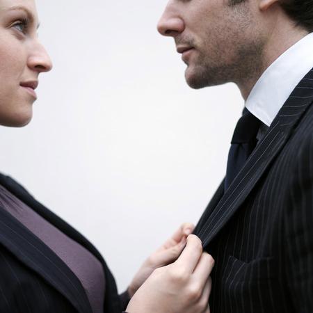 Businessman pulling businessmans suit photo