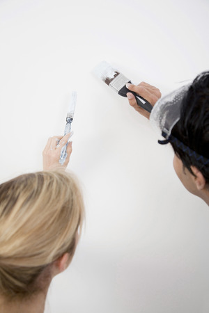 Couple painting the wall photo