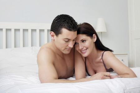 lying forward: Couple lying forward on the bed