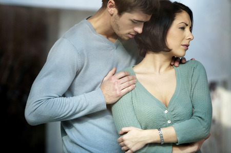 Man consoling his angry girlfriend photo