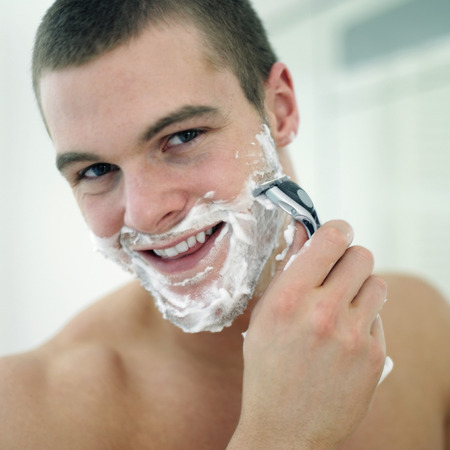 Man shaving his face photo