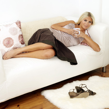 Woman lying on sofa photo