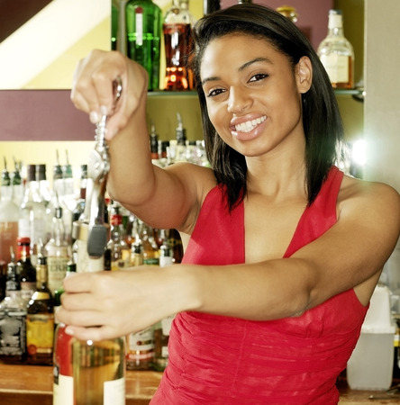 Woman showing how to open a bottle of wine photo