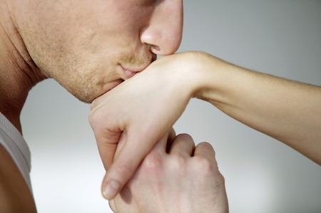 Man kissing his girlfriends hand photo