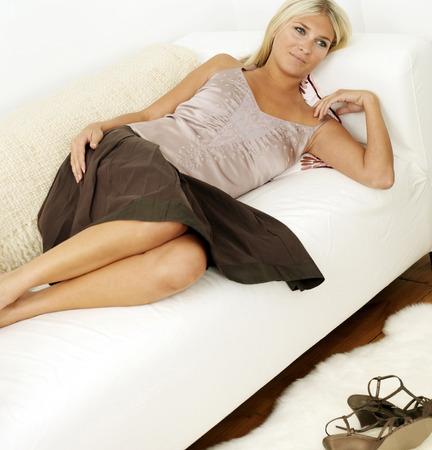 spaghetti strap: Woman relaxing on sofa