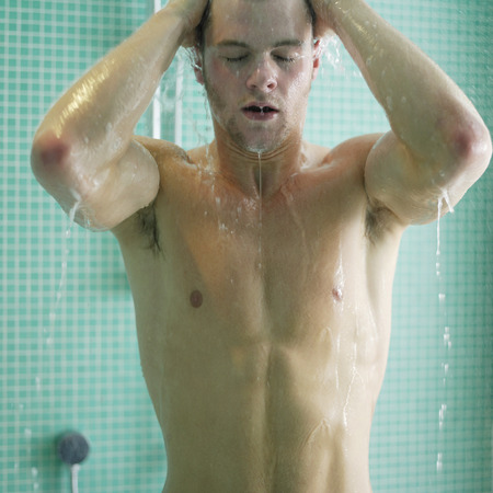 manlike: Man enjoying his shower time Stock Photo
