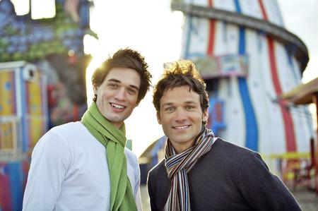 Two men at an amusement park photo