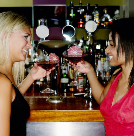housemate: Two women enjoying cocktail in a pub