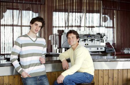 Two men at a beach bar photo