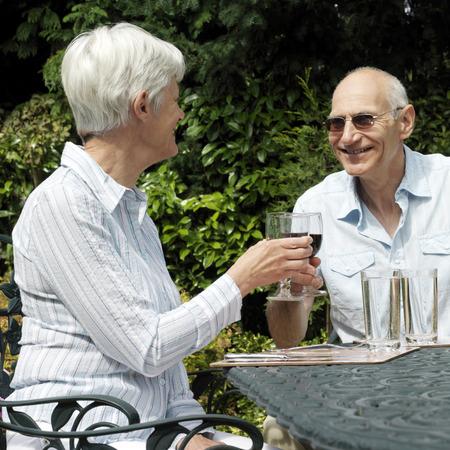 Senior couple enjoying red wine photo