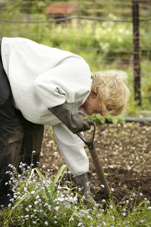 dug well: Senior woman doing some gardening work