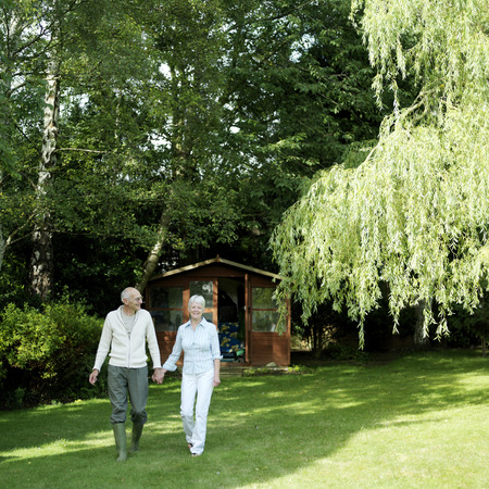 Senior couple relaxing in the garden photo