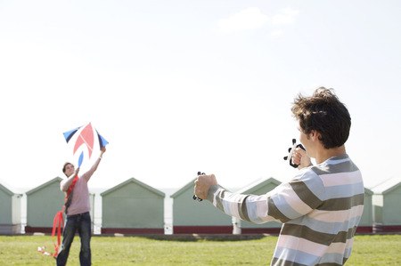 Two men flying a kite photo