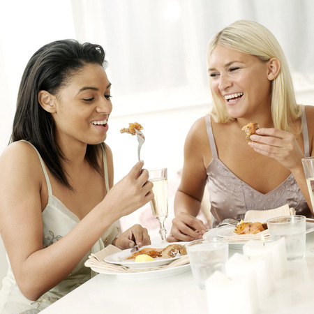 indulging: Two friends having meal together