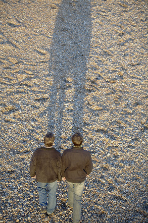 Two men walking photo
