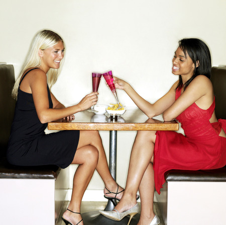 housemate: Two women spending leisure time together in a bar