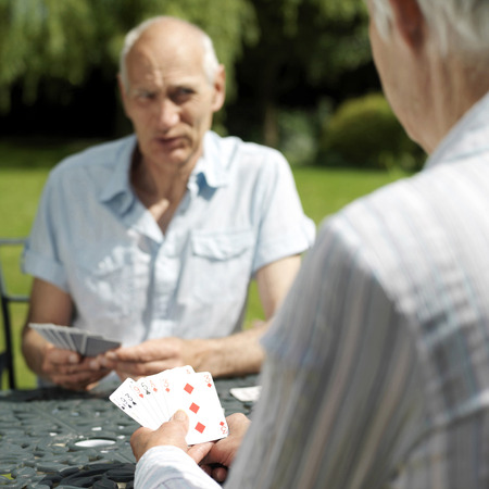 Senior couple playing cards photo