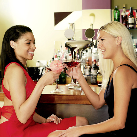 Two women toasting happily photo