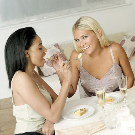 Two friends having meal together photo