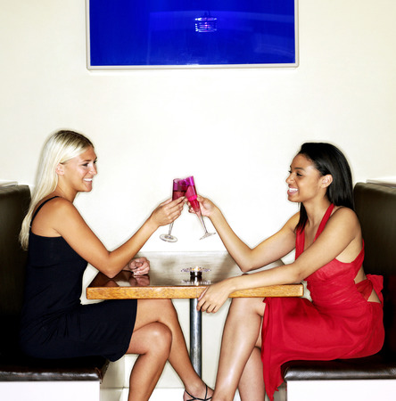 Two women spending leisure time together in a bar photo