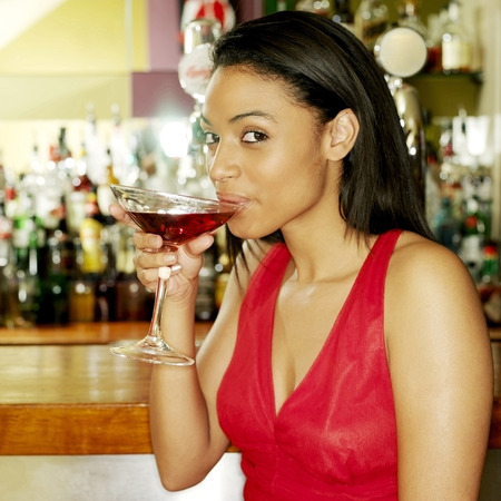 sociability: Woman spending leisure time in a pub Stock Photo