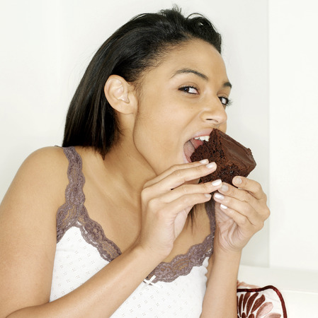 Woman enjoying a bar of chocolate photo