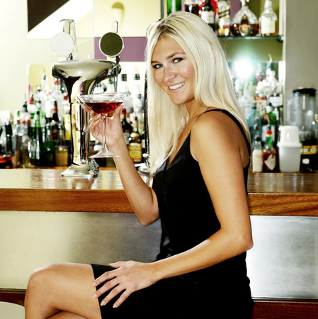Woman spending leisure time in a pub Stock Photo