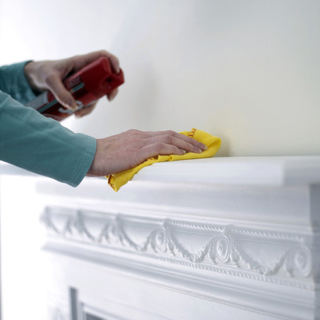 mantelpiece: Woman cleaning the mantelpiece  Stock Photo