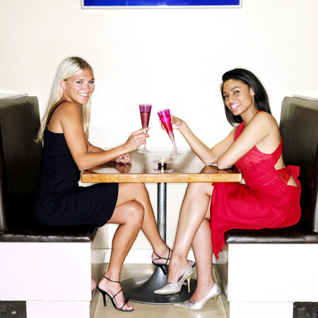 Two ladies spending leisure time together in a bar photo