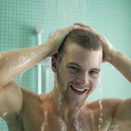 shower: Man enjoying his shower time Stock Photo