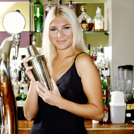 Woman holding a cocktail shaker photo