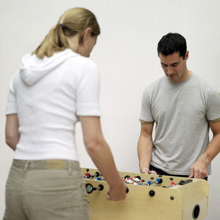 foosball: Couple playing foosball