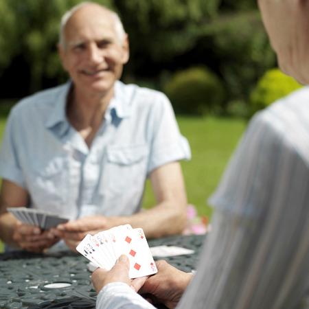 Senior couple playing cards photo