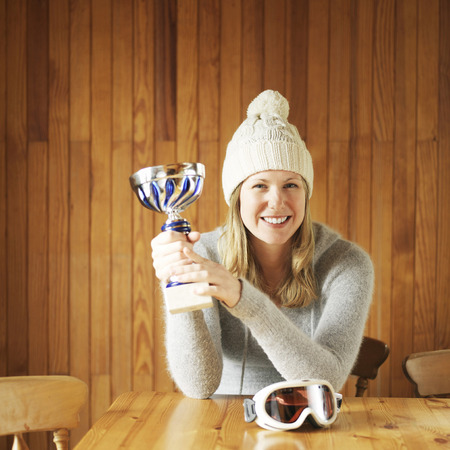Woman showing off her trophy photo